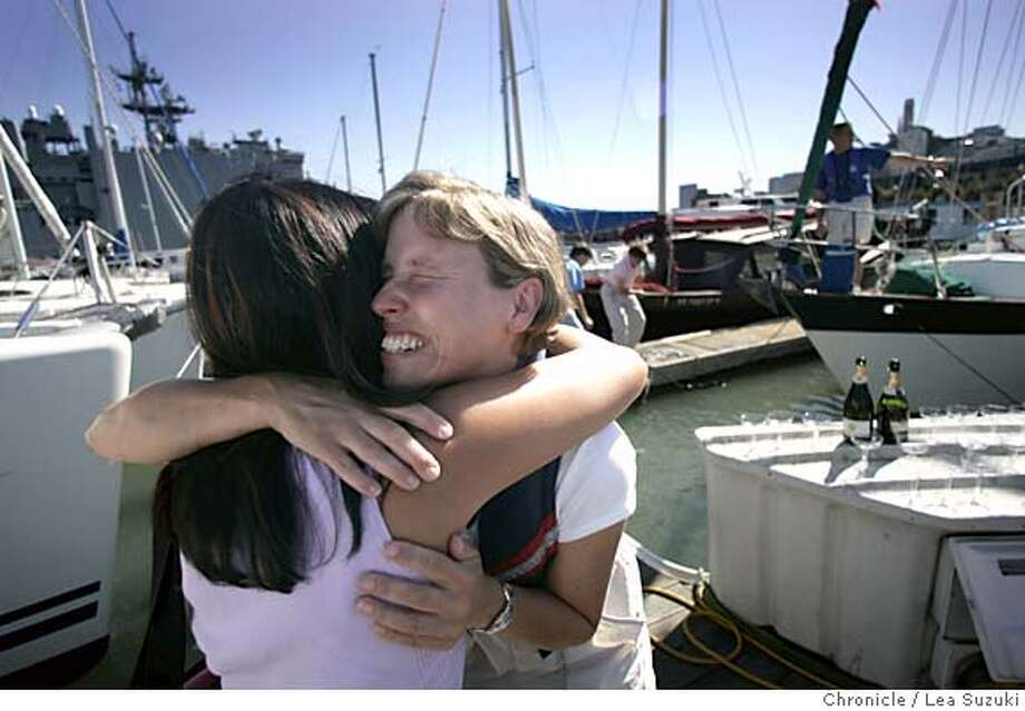 blind12_054_se.jpg From left: Divina Fontanilla says goodbye to Pam moments before Scott and Pam depart for their journey, Scott is on bow of boat in background. Scott Duncan, nearly three years ago,established the goal to be the first legally blind person to circumnavigate the globe in a sailboat.� Pamela Habek, who is also legally blind, is also sailing on the Tournesol. Together they will attempt to be the first legally blind people to independently sail around the world.� Departure date for the Blind Circumnavigation: Tournesol will depart between Monday October11, 2004 shortly after noon. The first planned leg of the journey is to make stops along the California coast in order to visit schools and agencies for the blind.� In late October Tournesol will join nearly 100 boats in San Diego to participate in the Baja Ha-Ha XI Cruiser's Rally to Cabo San Lucas.� From Cabo the planned itinerary is to continue south to Central America and then to head south west to the South Pacific.� Photo taken on 10/11/04 in San Francisco, CA. Photo by LEA SUZUKI/The San Francisco Chronicle Metro#Metro#Chronicle#10/12/2004#ALL#5star##0422408044 Photo: LEA SUZUKI