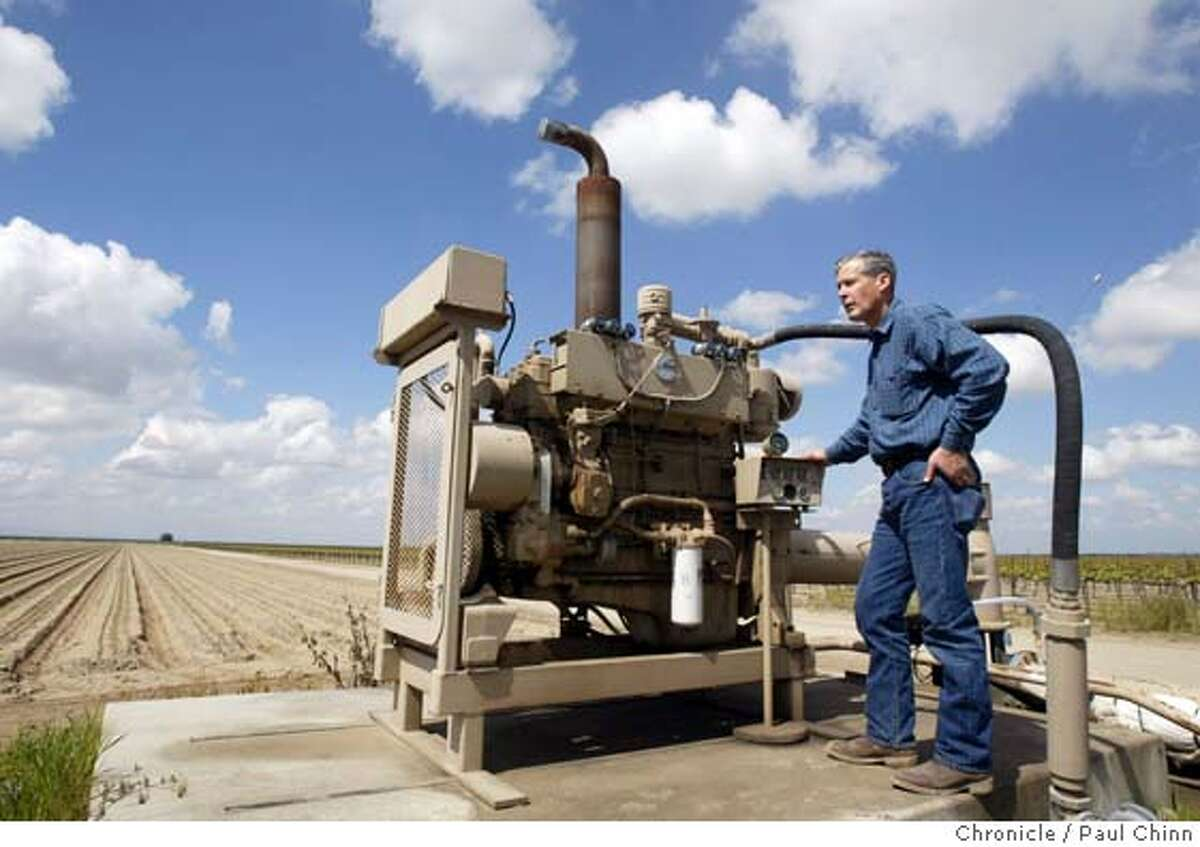 oilimpact_090_pc.jpg Don Cameron inspects one of the 41 natural gas-powered water pumps at Terranova Ranch on 3/24/05 in Helm, CA. General Manager Don Cameron says rising fuel costs for diesel and natural gas has severely cut into the farm's profit margin. The cost of diesel alone has risen 50 cents per gallon over last year's prices and the farm consumes about 160,000 gallons of diesel fuel annually. PAUL CHINN/The Chronicle MANDATORY CREDIT FOR PHOTOG AND S.F. CHRONICLE/ - MAGS OUT