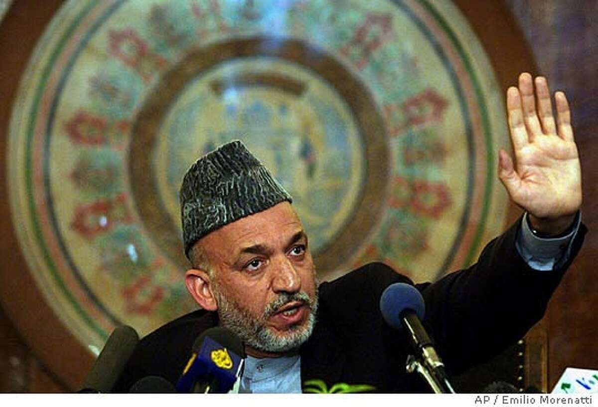 Afghan president Hamid Karzai gestures as he answer the journalists during the press conference in Kabul on Saturday, Oct.9, 2004. Afghanistan's first direct presidential election was thrust into turmoil hours after it started Saturday when all 15 candidates challenging interim leader Hamid Karzai alleged fraud over the ink meant to ensure people voted only once and vowed to boycott the results. (AP Photo/Emilio Morenatti)