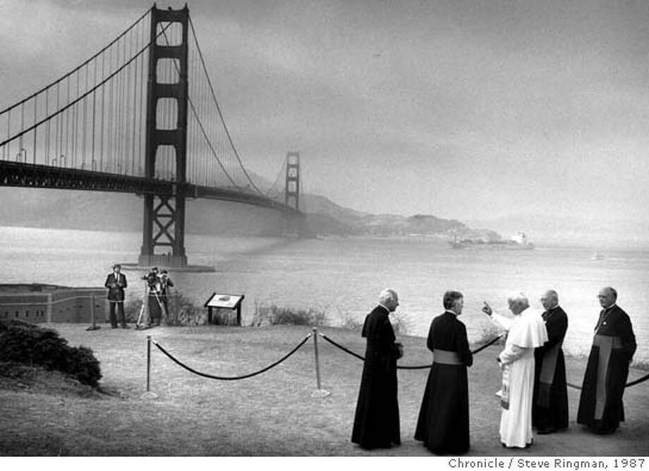 ** FILE ** Pope John Paul II with Archbishop John Quinn to his left and other unidentified Cardinals are seen at the Golden Gate Bridge in San Francisco, Sept. 18, 1987. (AP Photo/San Francisco Chronicle, Steve Ringman) Photo: STEVE RINGMAN