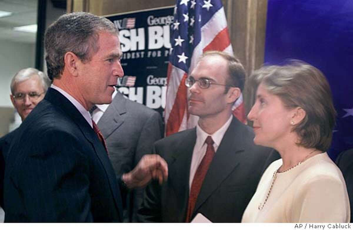 Republican presidential candidate George W. Bush talks with some of the gay Republicans he met with after a news conference Thursday, April 13, 2000, in Austin, Texas. At far left in background is former Rep. Steve Gunderson, of Washington, D.C., James L. McFarland of Milwaukee, and Rebecca Maestri of Washington, D.C. (AP Photo/Harry Cabluck) Ran on: 10-10-2004 As a candidate for president in 2000, George W. Bush talks with gay Republicans Jim McFarland and Rebecca Maestri in Austin. Former Rep. Steve Gunderson of Wisconsin is at far left.