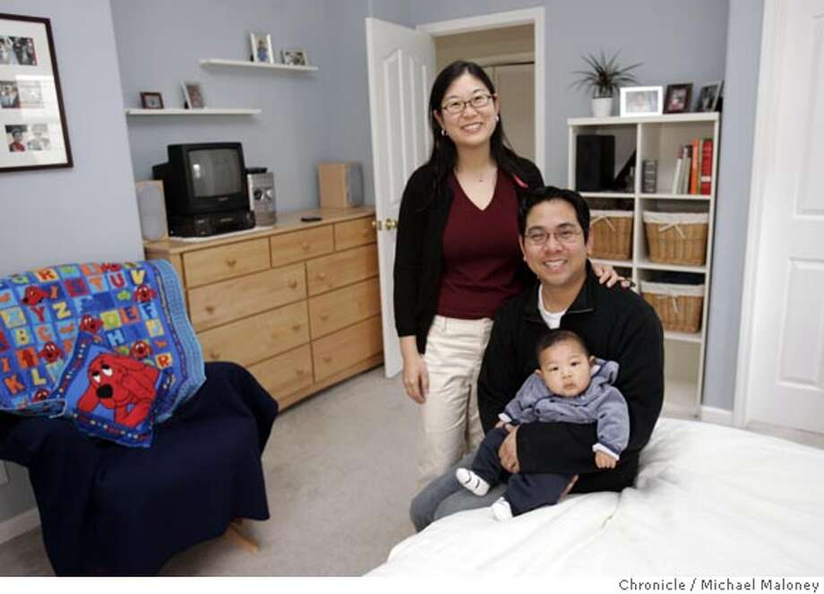 Lynna Tsou, her husband David Tjen and their son Emmett Tjen pose in their newly organized bedroom, which they vowed to clean up in 2005. Photo by Michael Maloney / San Francisco Chronicle Photo: Michael Maloney