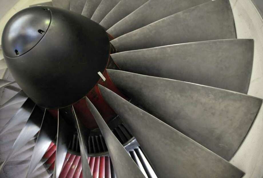 FILE - This March 31, 2010 file photo, shows a Pratt & Whitney engine during a media day tour company headquarters in East Hartford, Conn. United Technologies Corp. said Wednesday, Jan. 25, 2012, its fourth-quarter profit rose nearly 11 percent, propelled by growth in its aerospace businesses. Total revenue increased 1 percent. (AP Photo/Jessica Hill, File) Photo: Jessica Hill, ASSOCIATED PRESS / AP2010