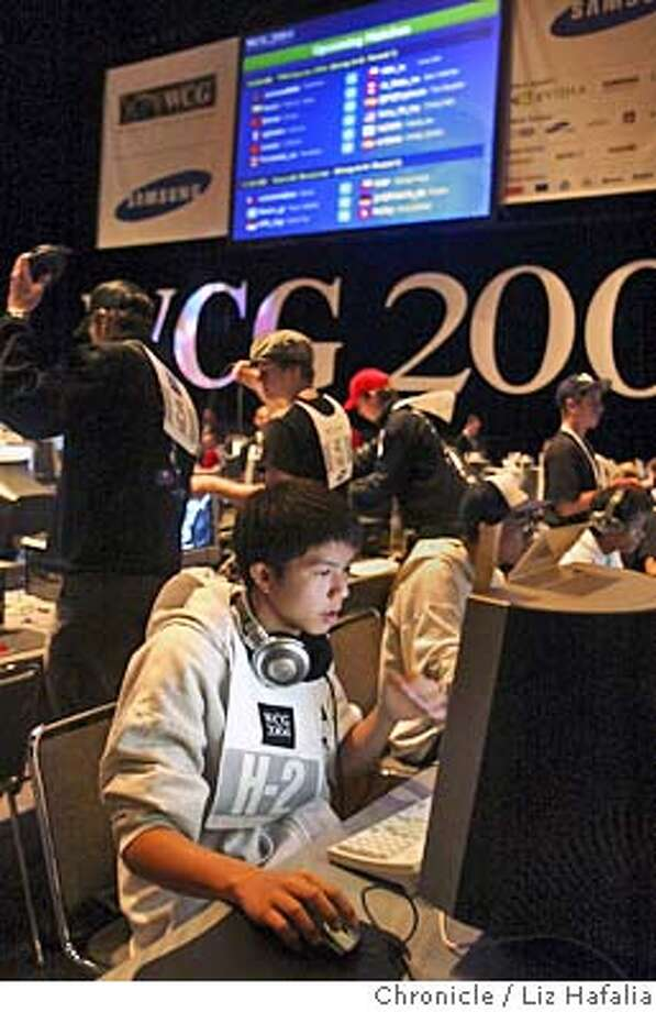 GAMES08_060_LH.JPG World Cyber Games at Bill Graham Civic Auditorium kicks off with hundreds of contestants from more than 60 countries playing video games against each other for fame and cash. Siwet Kruavit from Thailand who's game name is Nearly God in the tournament.  Shot on 10/7/04 in San Francisco. LIZ HAFALIA/The Chronicle MANDATORY CREDIT FOR PHOTOG AND SF CHRONICLE/ -MAGS OUT Business#Business#Chronicle#10/8/2004#ALL#5star##0422399941 Photo: Liz Hafalia