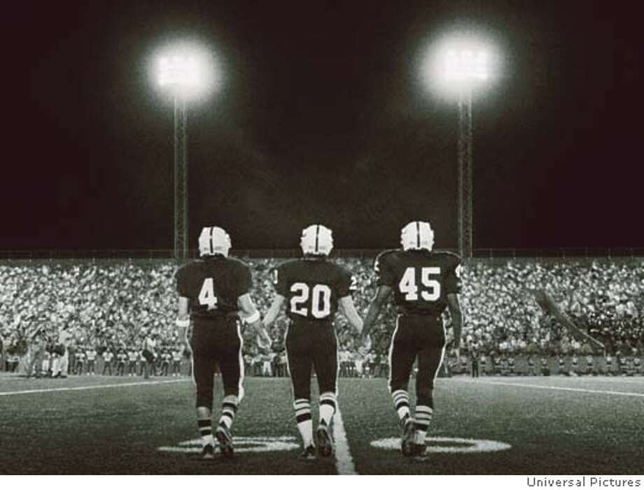 (L to r) Permian Panthers Brian Chavez (JAY HERNANDEZ, #4), Mike Winchell (LUCAS BLACK, #20) and Boobie Miles (DEREK LUKE, #45) take to the field for the pre-game coin toss in Imagine Entertainment?s adaptation of H.G. Bissinger?s prize-winning book, Friday Night Lights. Datebook#Datebook#Chronicle#10-08-2004#ALL#Advance##0422387904 Photo: Credit: Universal Pictures