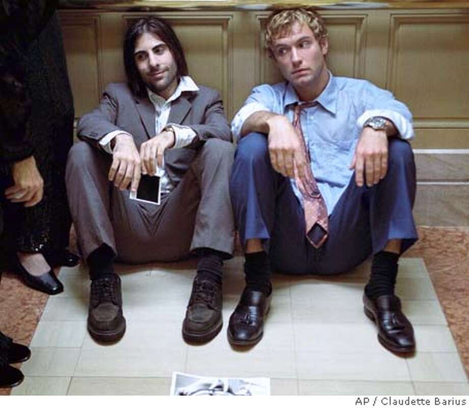 "(Left to right) Albert Markovski (Jason Schwartzman) examines his life, his relationships, and his conflict with Brad Stand (Jude Law), an executive climbing the corporate ladder at Huckabees department store in ""I Heart Huckabees."" (AP Photo/Claudette Barius) Datebook#Datebook#Chronicle#10/08/2004#ALL#Advance##0422376603 Photo: CLAUDETTE BARIUS"