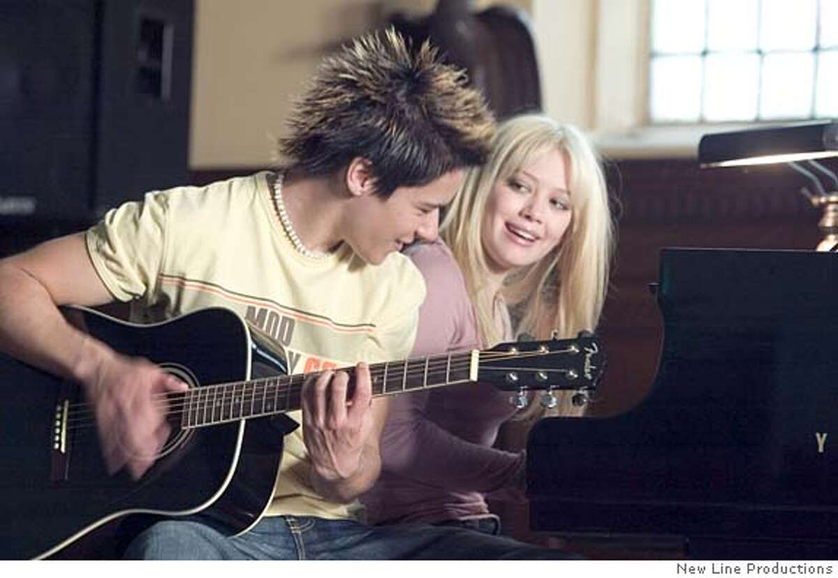 DF_05800 (left to right) Oliver James as Jay and Hilary Duff as Terri practice for their final performance in New Line Cinema�s upcoming film Raise Your Voice. Photo: (c) 2004 Zade Rosenthal/New Line Productions Ran on: 10-03-2004 Jay (Oliver James) and Terri (Hilary Duff) practice for their final performance in Raise Your Voice, opening Friday. Heart of Summer Datebook#Datebook#Chronicle#10/8/2004#ALL#5star##0422281415
