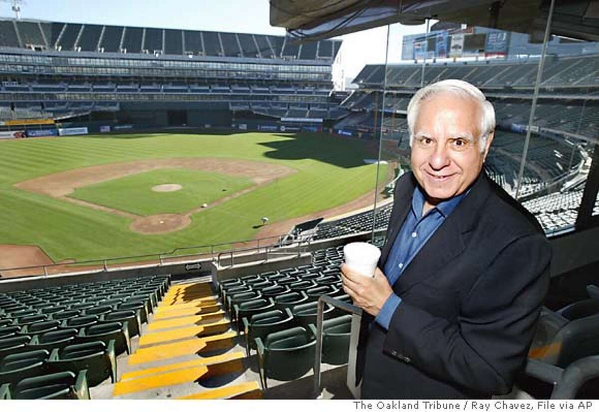 ** FILE ** Los Angeles real estate developer Lewis Wolff tours the Oakland A's baseball stadium in Oakland, Calif., Friday, March 11, 2005. Baseball's owners unanimously approved the sale of the Oakland Athletics to Wolff on Wednesday, March 30, 2005, all but finalizing a deal in the works for about a year. (AP Photo/The Oakland Tribune, Ray Chavez)
