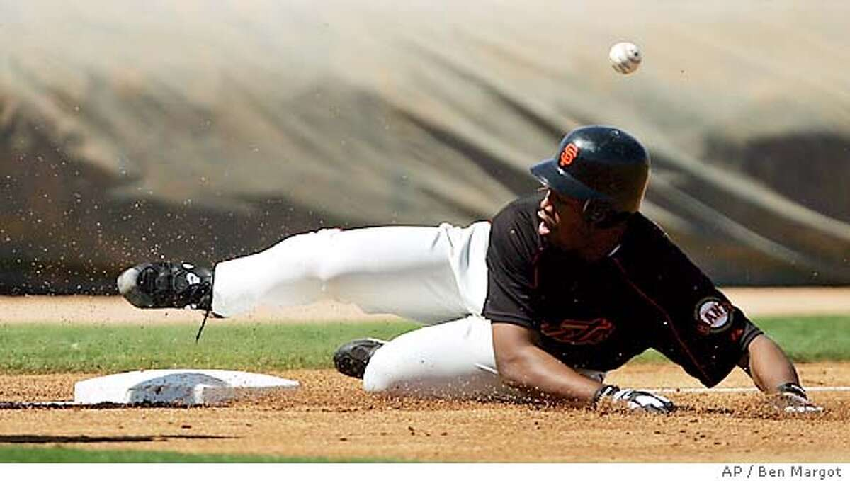 San Francisco Giants pitcher Jerome Williams slides safe into third base ahead of the ball with a two run triple in the second inning against the Arizona Diamondbacks Tuesday, March 29, 2005, during a spring training game in Scottsdale, Ariz. (AP Photo/Ben Margot)