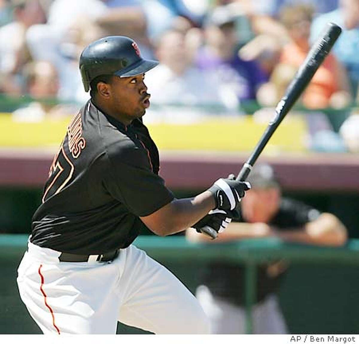 San Francisco Giants pitcher Jerome Williams swings for a two run triple in the second inning off Arizona Diamondbacks' Brad HalseyTuesday, March 29, 2005, during a spring training game in Scottsdale, Ariz. (AP Photo/Ben Margot)