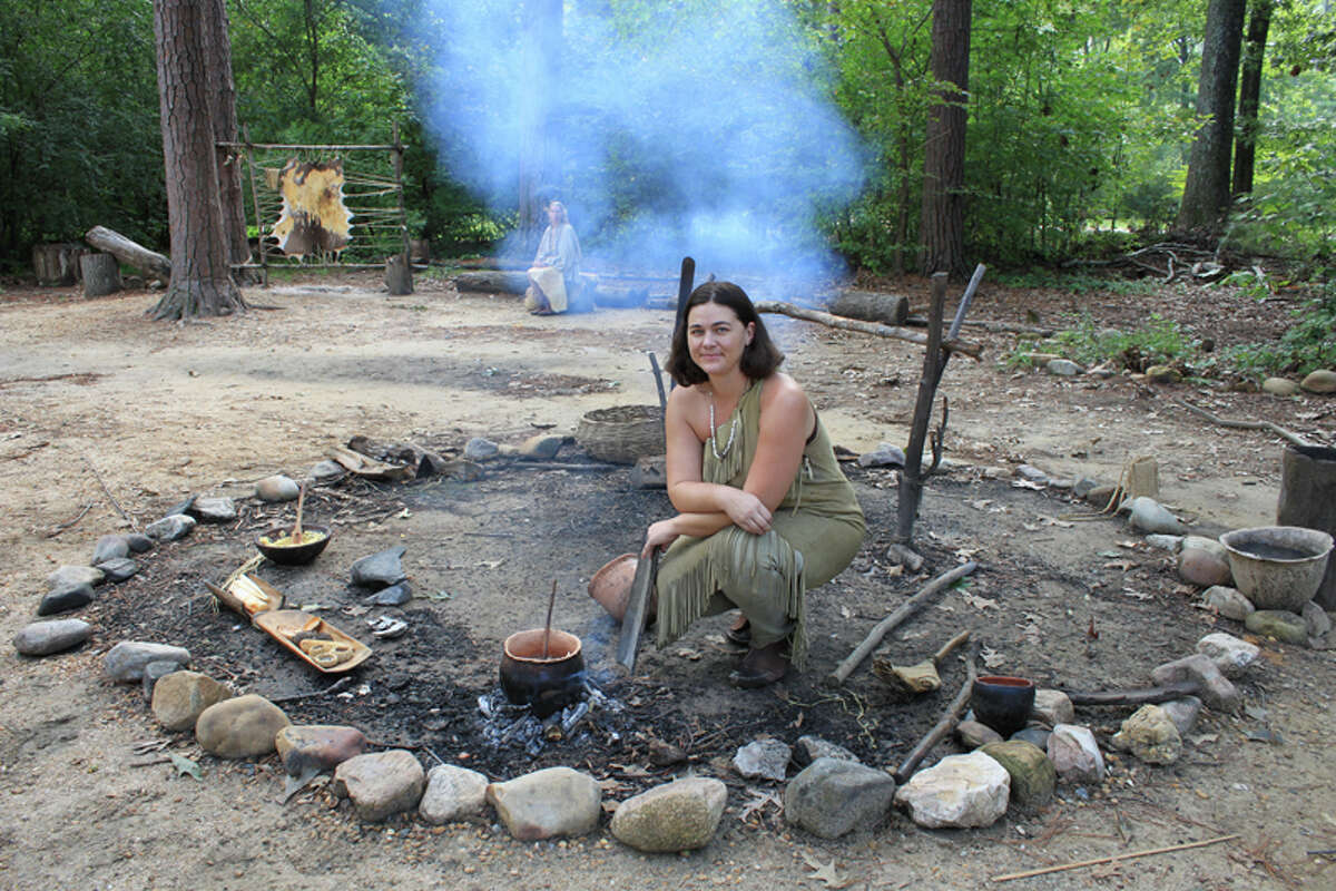 Trav Jamestown 8 - Costumed interpreters demonstrate Powhatan Indian cooking. PHOTO BY KATHLEEN SCOTT Special to the Express-News.