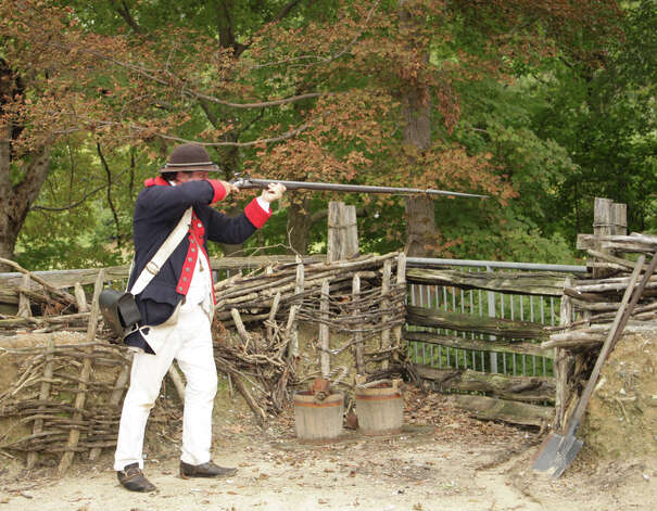 Trav Jamestown 2 -  Firing of a Revolutionary War musket at the Yorktown Victory Center  PHOTO BY KATHLEEN SCOTT Special to the Express-News.