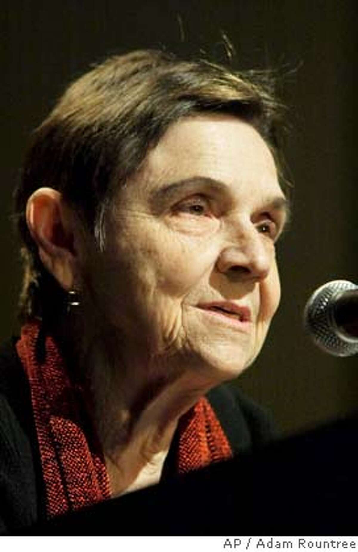 Adrienne Rich speaks at the 2004 National Book Critics Circle Award in New York, Friday, March 18, 2005. Rich won the poetry award for her book The School Among The Ruins. (AP Photo/Adam Rountree) Ran on: 03-25-2005 Ran on: 03-25-2005