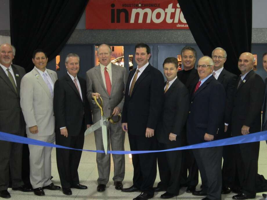 Jack Sweeney, President and Publisher, of the Houston  Chronicle did the ribbon cutting honors at the 2012 Houston Auto Show Preview  Night event.