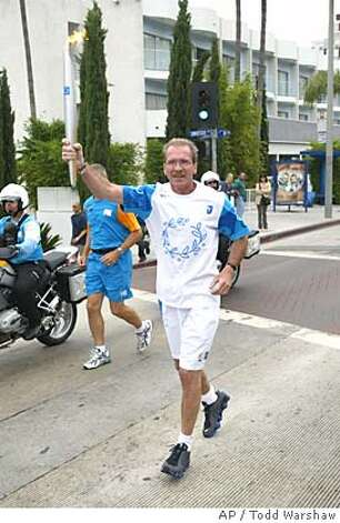 "Television host Pat O'Brien carries the Olympic torch through Los Angeles Wednesday, June 16, 2004. O'Brien, anchor of ""The Insider"" television news magazine show, has entered an alcohol rehabilitation program, he said in a written statement Sunday, March 20, 2005 to The Associated Press. (AP Photo/IOC,Todd Warshaw ) Photo: TODD WARSHAW"