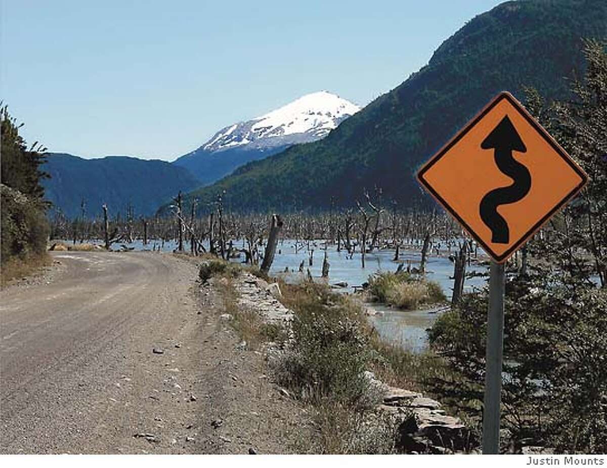A road sign points the way along a mountainous stretch of Chile's Southern Highway. Photo by Justin Mounts