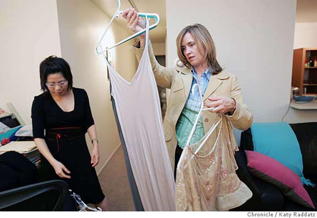EBAYBIZ26085_RAD.JPG Found Value is a San Francisco company that assigns specialists to go to one's home, asses the value of one's belongings, then put said belongings up for sale on eBay. SHOWN: Found Value specialist Kim Dempster (blond hair) helps Celine Teoh of San Francisco pick out items for sale on eBay. Kim looks closely at a slinky viscose dress before deciding to take it. Photo taken on 3/24/05, in San Francisco, CA. By Katy Raddatz / The San Francisco Chronicle MANDATORY CREDIT FOR PHOTOG AND SF CHRONICLE/ -MAGS OUT