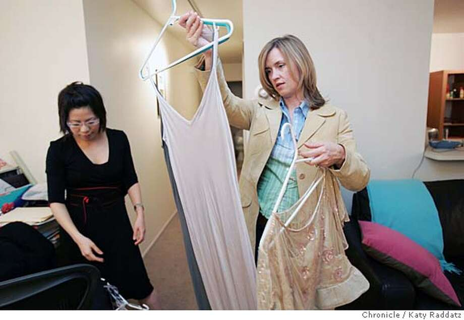 EBAYBIZ26085_RAD.JPG Found Value is a San Francisco company that assigns specialists to go to one's home, asses the value of one's belongings, then put said belongings up for sale on eBay. SHOWN: Found Value specialist Kim Dempster (blond hair) helps Celine Teoh of San Francisco pick out items for sale on eBay. Kim looks closely at a slinky viscose dress before deciding to take it. Photo taken on 3/24/05, in San Francisco, CA.  By Katy Raddatz / The San Francisco Chronicle MANDATORY CREDIT FOR PHOTOG AND SF CHRONICLE/ -MAGS OUT Photo: Katy Raddatz