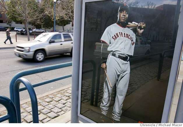 bonds_046_mac.jpg -Along the Embarcadero several of the light rail train stop shelters have the new SF Giants advertising, Barry Bonds with small bats. Barry Bonds remains an integral part of the San Francisco Giants' marketing campaign, notwithstanding the allegations that are swirling around him. Some marketing professionals think it's appropriate to keep some distance from someone who is a lightening rod, but the Giants are sticking by their man, one of the best ballplayers ever.  A new outdoor ad campaign is being put up today. It shows four of the Giants. 3/24/05 Oakland, Ca Michael Macor / San Francisco Chronicle Mandatory Credit for Photographer and San Francisco Chronicle/ - Magazine Out Photo: Michael Macor