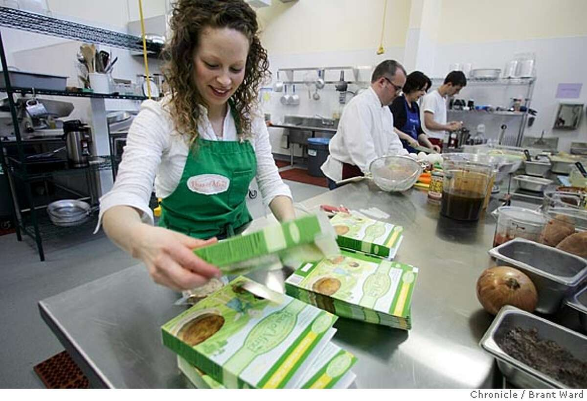 """Jill Litwin works to package her organic children's food called """"Peas of Mind"""" at the kitchen. La Cocina in the Mission district of San Francisco will assist low income immigrant women develop their food service businesses by providing commercial kitchen and storage spaces, mentorship and training. Brant Ward 3/15/05"""