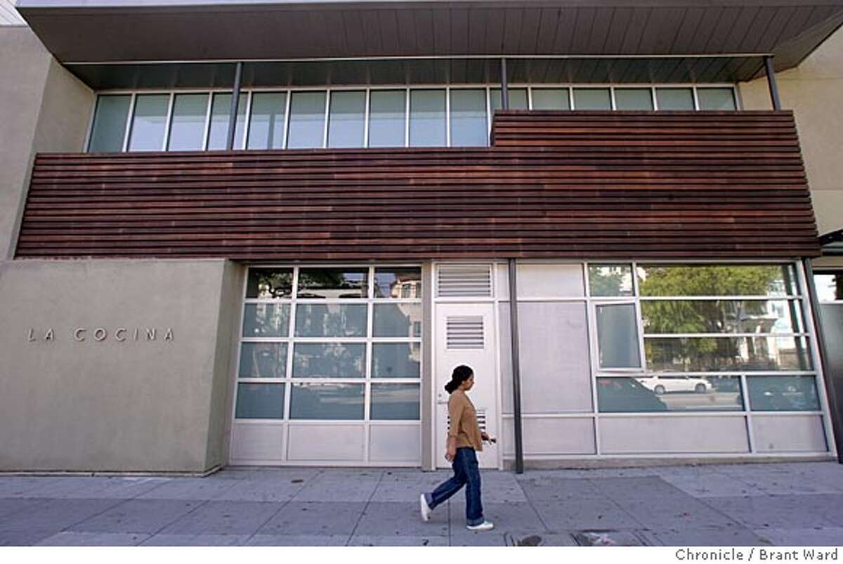 The front of the modern looking La Cocina on Folsom Street. La Cocina in the Mission district of San Francisco will assist low income immigrant women develop their food service businesses by providing commercial kitchen and storage spaces, mentorship and training. Brant Ward 3/15/05
