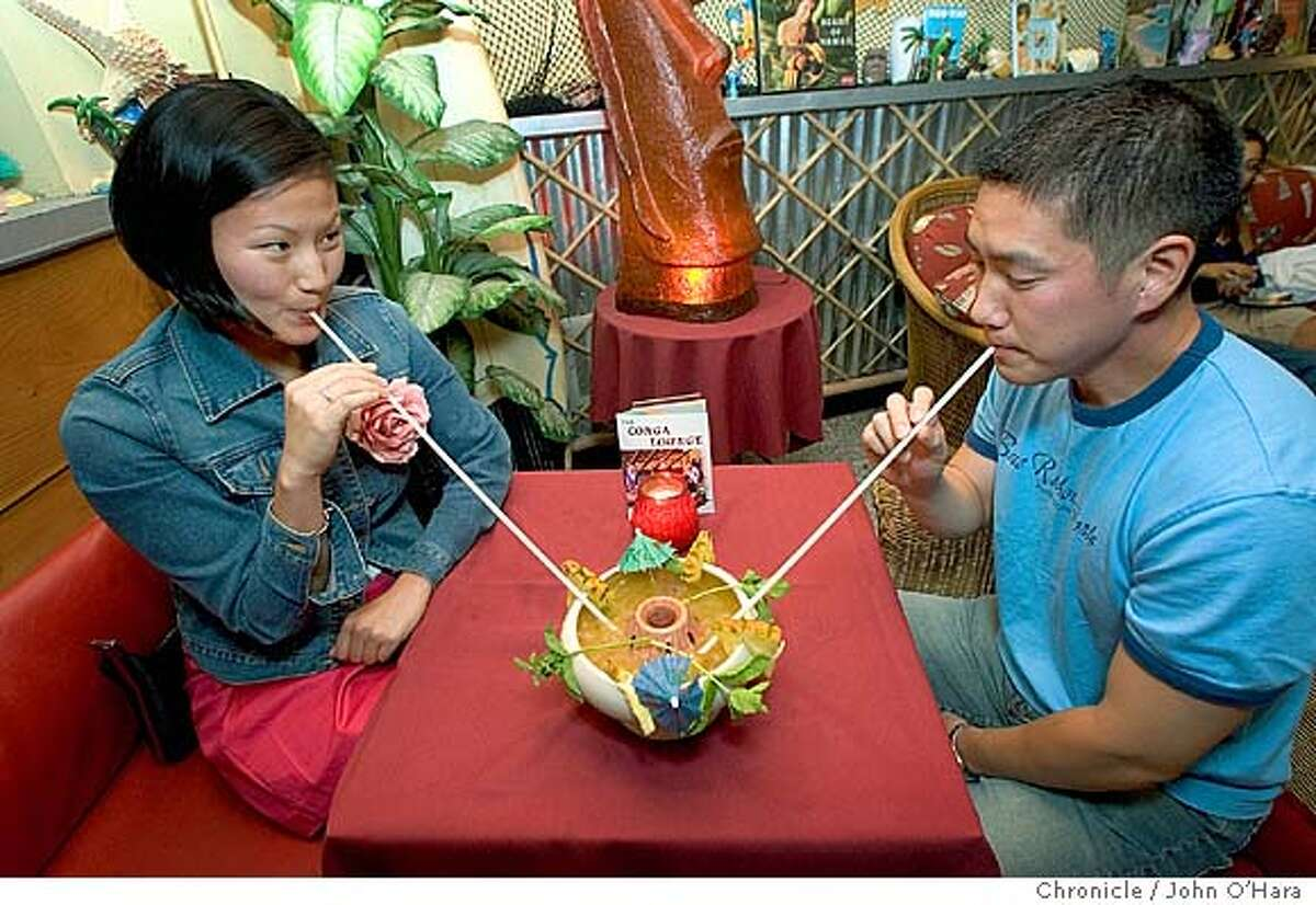 Conga Lounge, 5422 College Ave. Oakland,CA Otto von Stroheim, local TIki expert. in a tiki bar like bars of the 40's and 50's. June Kim (left) and Doug Hong, share an exotic drink, with long straws photo/John O'Hara