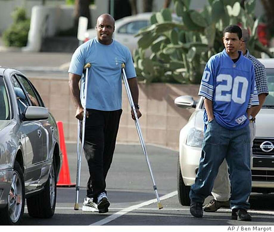 San Francisco Giants' Barry Bonds returns to spring training camp Tuesday, March 22, 2005, in Scottsdale, Ariz. Bonds has returned to Giants camp for rehabilitation since a second arthroscopic surgery on his right knee last week. At right is his son, Nikolai Bonds. (AP Photo/Ben Margot) Photo: BEN MARGOT