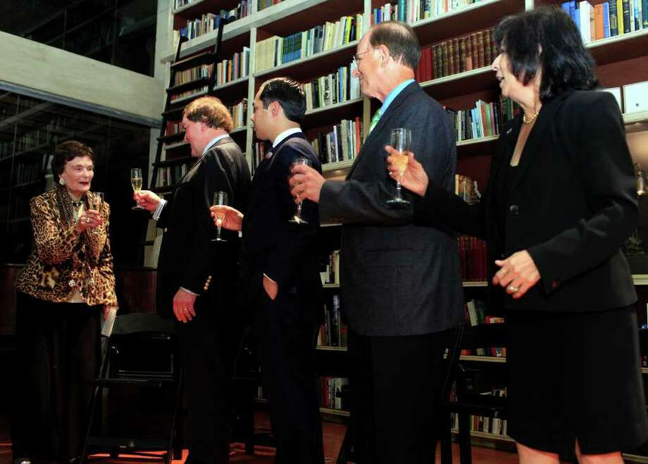 Lila Cockrell, from left, event host Bruce Bugg, Jr., Mayor Julián Castro, Bexar County Judge Nelson Wolff and event chairperson Evangelina Flores raise glasses of Champagne in a toast at Cockrell's 90th birthday celebration at The Tobin Estate. Photo: J. Michael Short, For The Express-News / THE SAN ANTONIO EXPRESS-NEWS