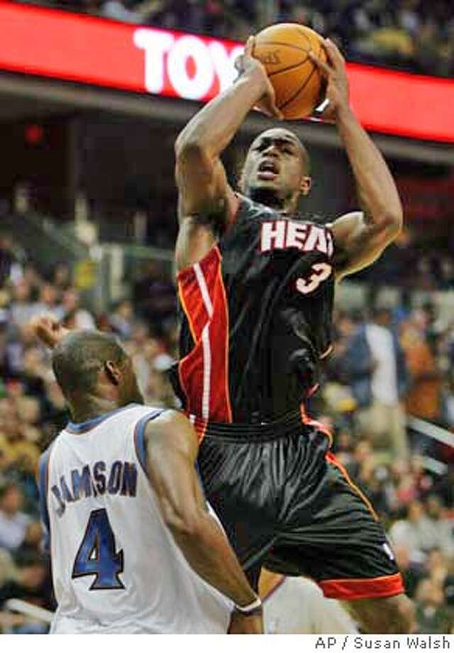 4f95d4b4f0d Miami Heat guard Dwayne Wade (3) goes up and over Washington Wizards  forward Antwan