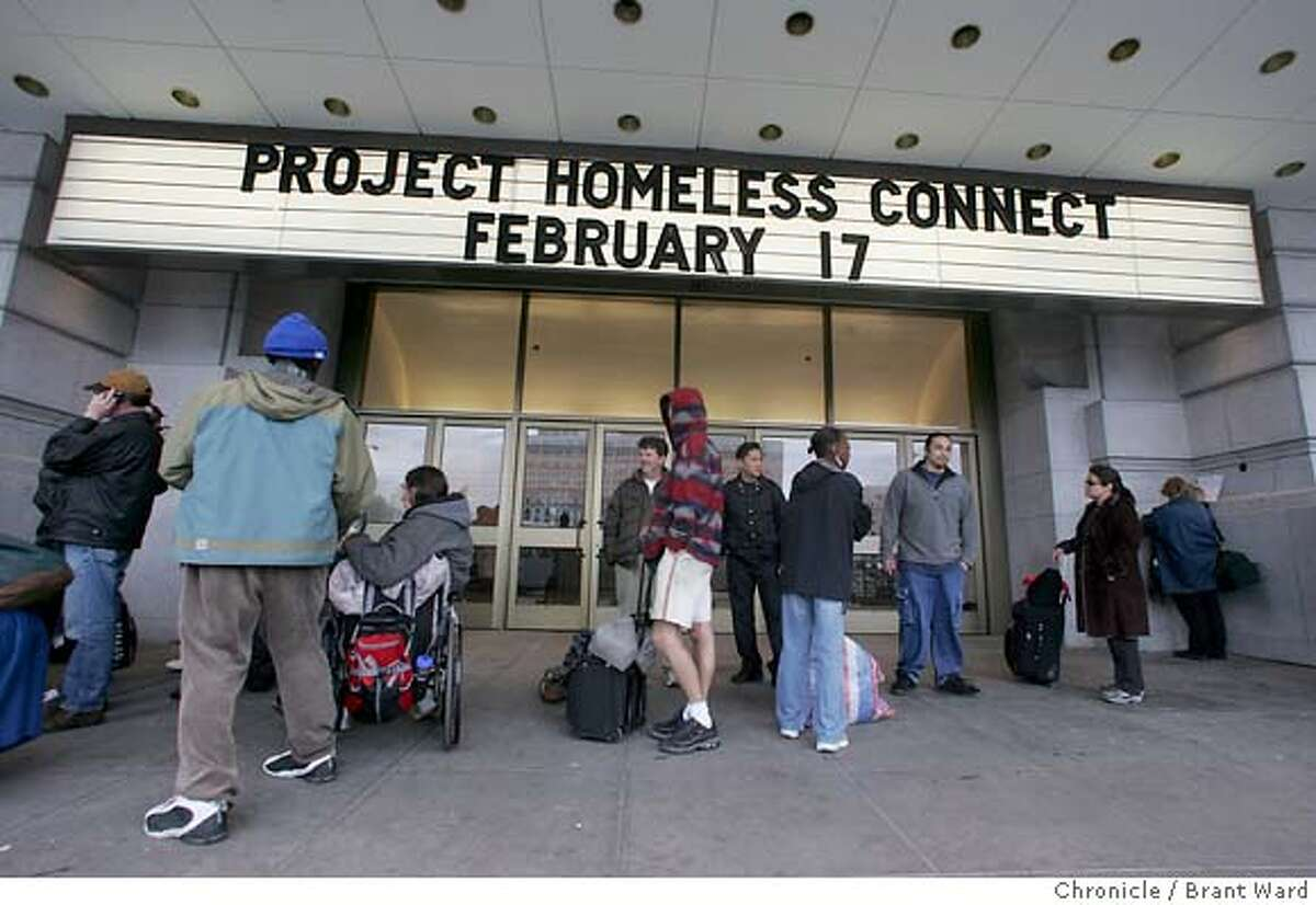 outreach026_ward.jpg People lined up to take advantage of the support services and referrals offered under a large sign proclaiming the homeless outreach day. San Francisco conducted its' latest Project Homeless Connect at the Bill Graham auditorium Thursday. Brant Ward 2/18/05 At last month's