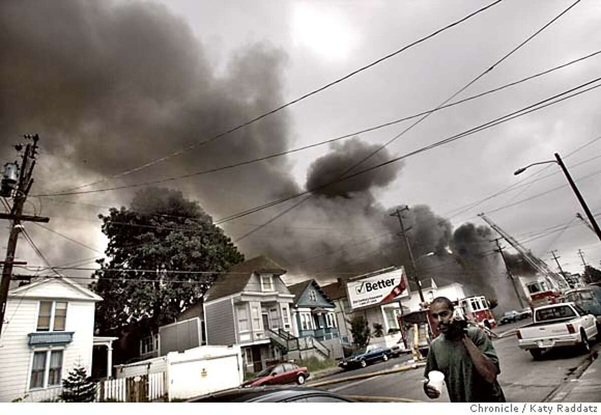 SHOWN: Clouds of dark smoke blanket the West Oakland neighborhood near 14th and peralta Streets as the West Coast Kingdom Mt. Zion Spiritual Center, corner of 14th St. and Peralta Sts. burns and burns. A passerby said,