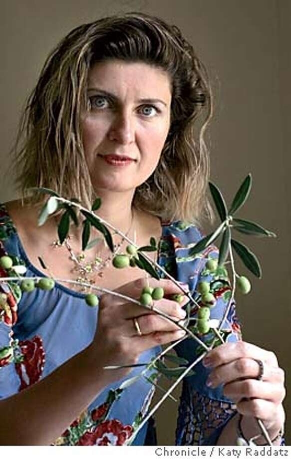 MACARTHUR055_rad.jpg Maria Mavroudi is one of seven Bay Area winners of the Macarthur Fellowship Grant. Maria is a philologist who uses her language detective skills to reveal a new understanding of linguistic and cultural exchanges between medieval Byzantium and its Islamic Middle Eastern neighbors. She holds an olive branch from her tree. Katy Raddatz / The Chronicle MANDATORY CREDIT FOR PHOTOG AND SF CHRONICLE/ -MAGS OUT Metro#MainNews#Chronicle#9/28/2004#ALL#5star#A11#0422377351 Photo: Katy Raddatz
