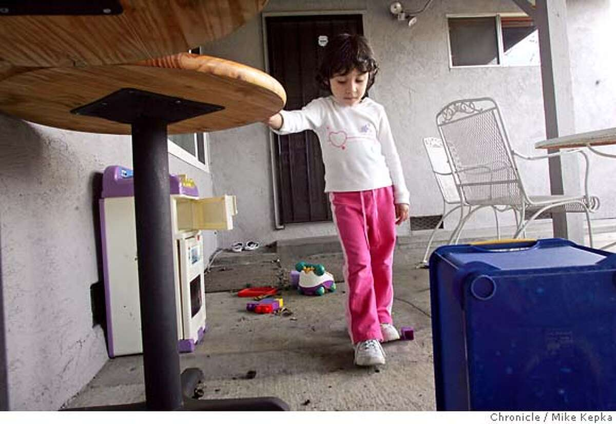 Janessa McCaffrey, 3, plays in her back yard. Her father Patrick MaCaffrey was one of Tracy's casualties of the Iraq War. We visit the town of Tracy, California on the two year anniversary of the Iraq War after is has been said they have statistically lost more more soldiers per capita that other towns. Mike Kepka / The Chronicle