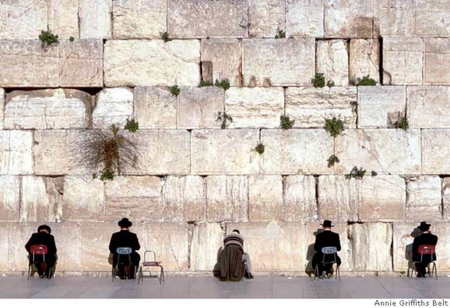 Men gather before the Western Wall to pray. The wall, which qualifies as a synagogue, is a holy site for Jews. April 1995 Jerusalem, Israel Photo: Annie Griffiths Belt