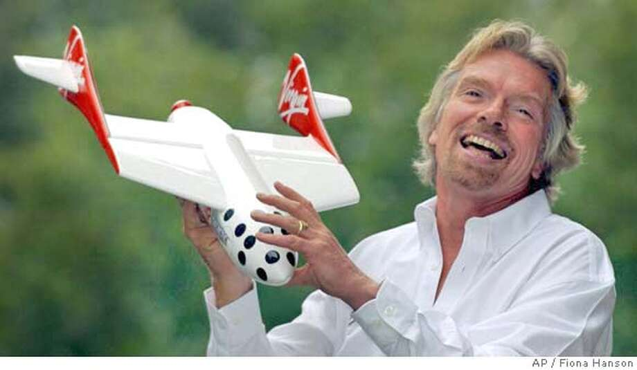 British entrepreneur Richard Branson poses for photographers after he announced Monday that his Virgin company plans to launch commercial space flights over the next few years in London Monday Sept 27, 2004. The Virgin transport, entertainment and communications group has signed an agreement with pioneering aviation designer Burt Rutan to build an aircraft based on Rutan's SpaceShipOne vessel, Branson said. (AP Photo/PA Fiona Hanson ) ** UNITED KINGDOM OUT MAGS OUT ** Photo: FIONA HANSON