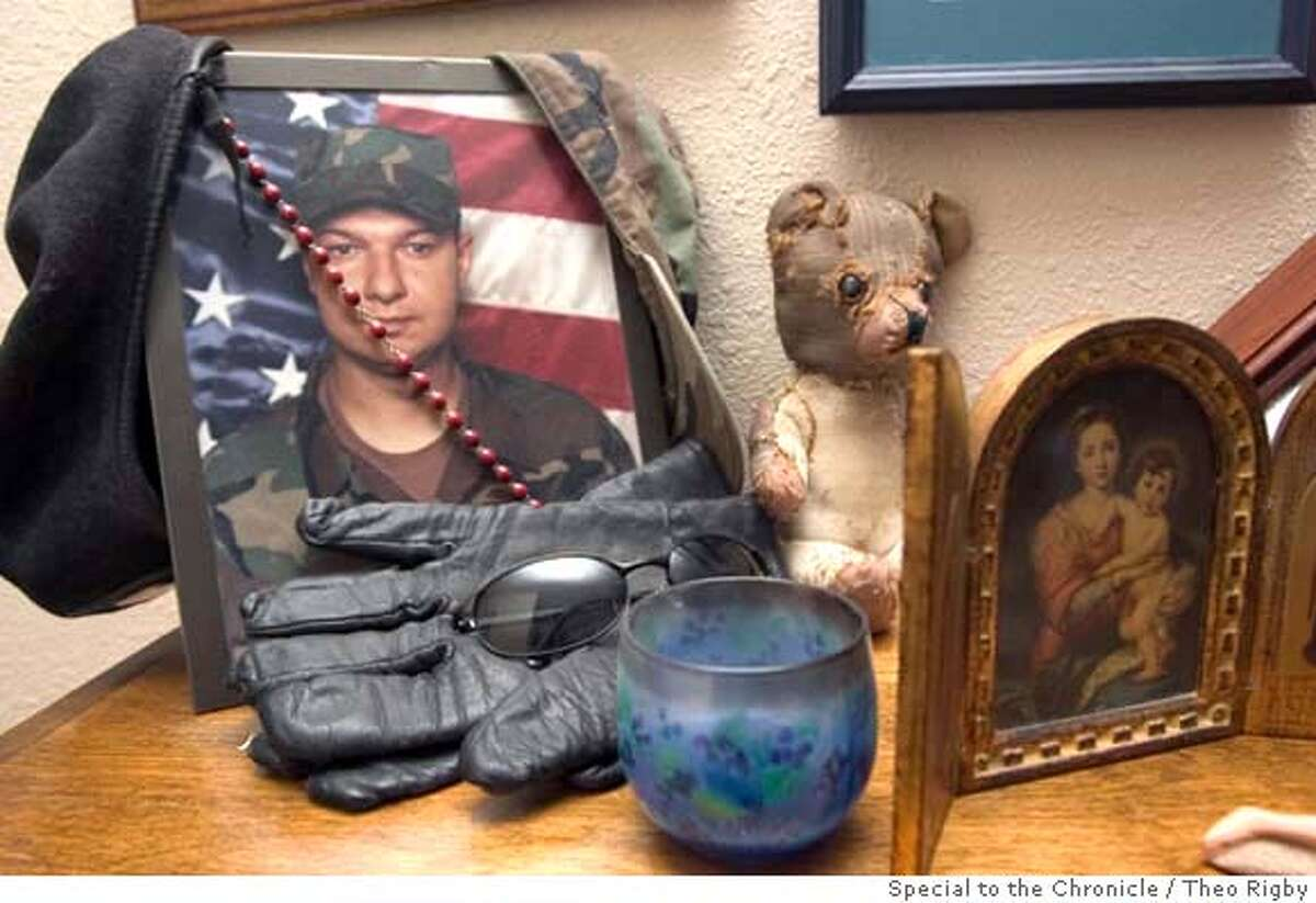CASEY-A family shrine for Casey Sheehan of Vacaville, Ca. who was killed in Sadr City, Iraq on April 4, 2004 sits in the family livingroom. BY THEO RIGBY/SPECIAL TO THE CHRONICLE ONE-TIME USE ONLY TV OUT, NO MAGS, , REPRINT OR REPRODUCTION BY PERMISSION FROM RUSSELL YIP ONLY
