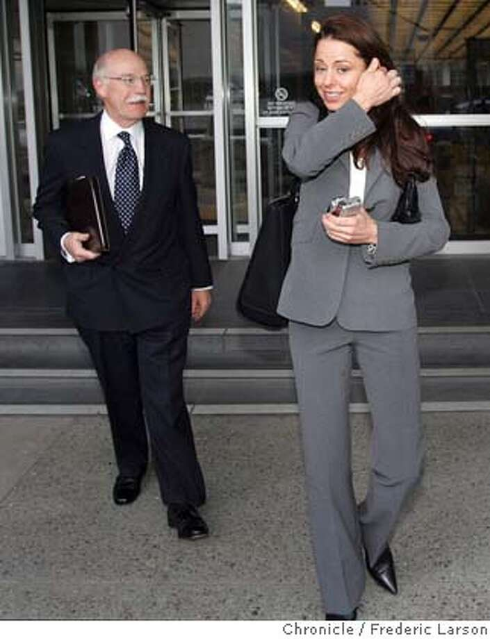 BALCO_BELL_004_fl.jpg Kimberly Bell leaves the S.F Federal Court house with her lawyer Hugh Levine after she testified for two hours before a federal grand jury regarding Barry Bonds' alleged use of steroids and his alleged use of cash to buy a house in Scottsdale. 3/18/05 San Francisco CA Frederic Larson The San Francisco Chronicle Photo: Frederic Larson