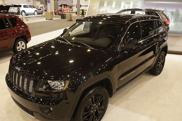 "The ""blacked out"" look Jeep Grand Cherokee on display at the 2012 Houston Auto Show at Reliant Center, Tuesday, Jan. 24, 2012, in Houston.  This is the US debut of the concept Jeep Grand Cherokee that will later go into production. ( Melissa Phillip / Houston Chronicle )  NOTE---EMBARGO until 9am JAN 25"