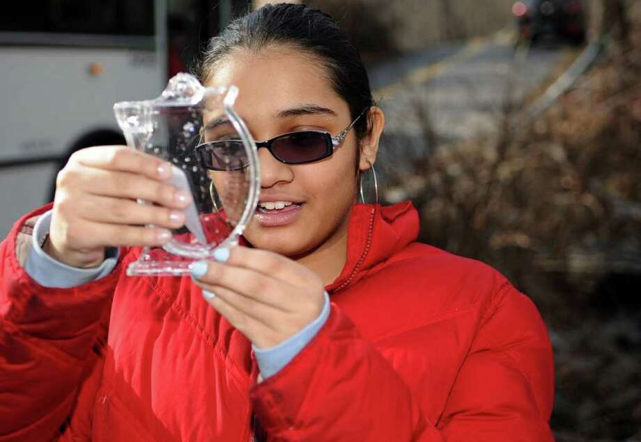 Scofield Magnet School student Umaiya Rajpar tests water at Bargh Pump Station in Stamford on Wednesday, January 25, 2012. The students are learning about water quality through work with Hewlitt Packard and SoundWaters. Photo: Lindsay Niegelberg / Stamford Advocate