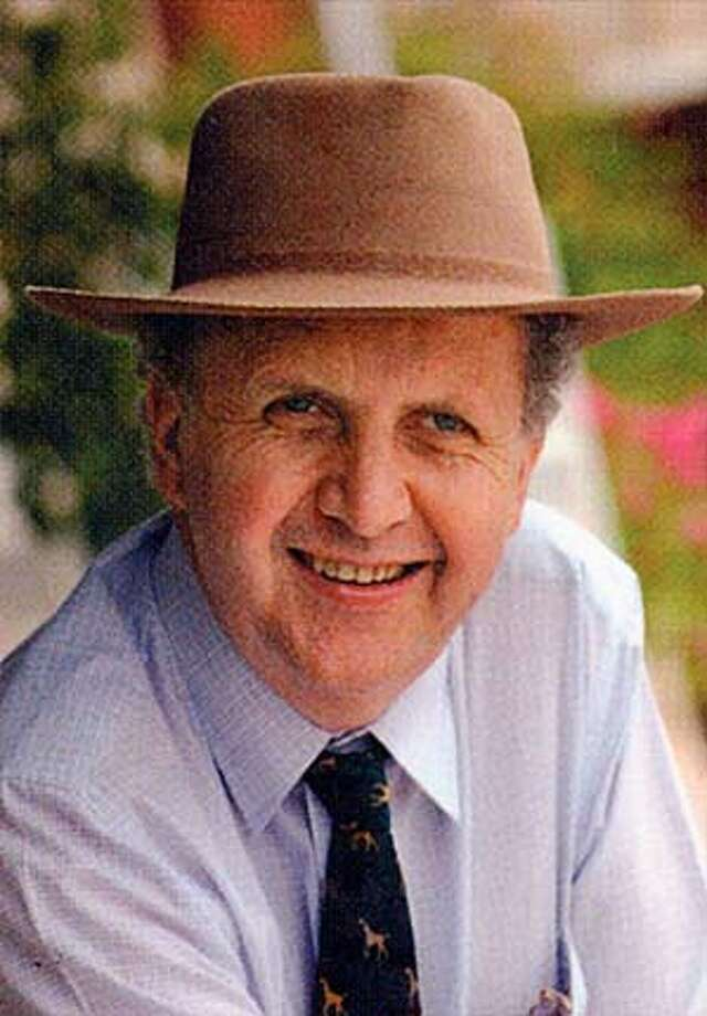 Author Alexander McCall Smith from the dust jacket of his book THE FULL CUPBOARD OF LIFE.