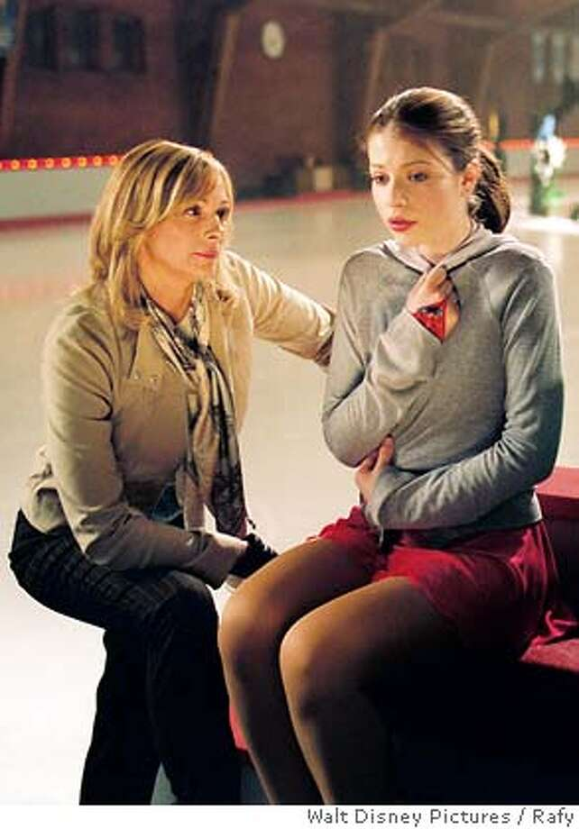 "In this photo provided by Walt Disney Pictures, Tina (Kim Cattrall) coaches Casey (Michelle Trachtenberg) to become a better figure skater in ""Ice Princess."" (Walt Disney Pictures/Rafy) Photo: RAFY"