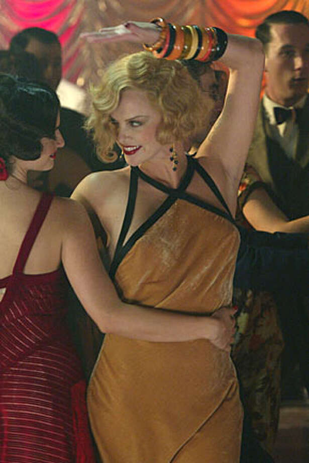 HEAD24.JPG Penelope Cruz as Mia and Charlize Theron as Gilda Besse in Head In The Class. Pierre Dury Ran on: 09-24-2004  Mia (Penelope Cruz, left) and Gilda (Charlize Theron) are roommates and friends in &quo;Head in the Clouds.&quo; Ran on: 09-24-2004 Ran on: 09-24-2004 Photo: Pierre Dury