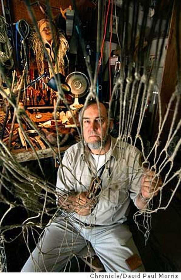 Naturalist Norm Kidder builds a fishing net using techniques developed by American Indians before Europeans arrived. Chronicle photo by David Paul Morris