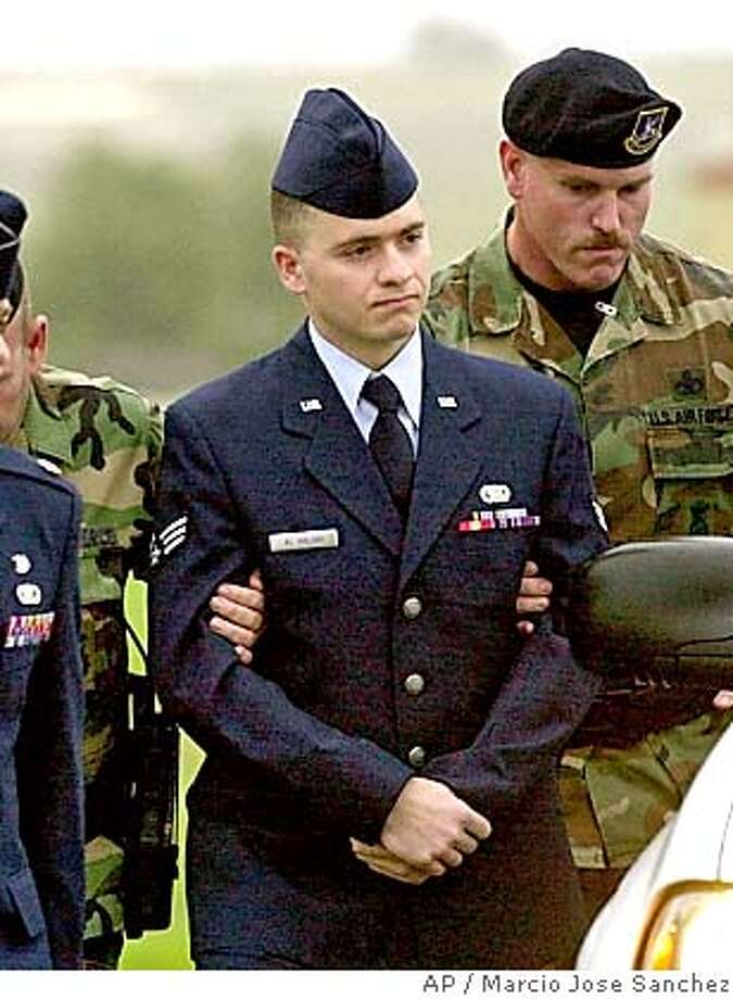 "**FILE ** Senior Airman Ahmad I. Al Halabi, center, is escorted to his arraignment at Travis Air Force Base, Calif., Jan. 13, 2004. Lawyers for the translator accused of spying have asked the government to dismiss the most serious charges against Al Halabi after learning that documents he's accused of trying to deliver to Syria aren't classified, after all. The U.S. Air Force acknowledged Wednesday, Sept. 8, 2004, that a team of experts determined most of the documents found in Al Halabi's possession when he was arrested in July 2003 were considered ""for official use only,"" but were not classified. One document was classified ""secret,"" but the Air Force would not elaborate. (AP Photo/Marcio Jose Sanchez, file) Ran on: 09-12-2004  Ahmad I. Al Halabi, shown in a January photo, plans to ask for a dismissal of espionage charges. Ran on: 09-12-2004  Ahmad I. Al Halabi, shown in a January photo, plans to ask for a dismissal of espionage charges. JAN 13 2004 FILE PHOTO Photo: MARCIO JOSE SANCHEZ"