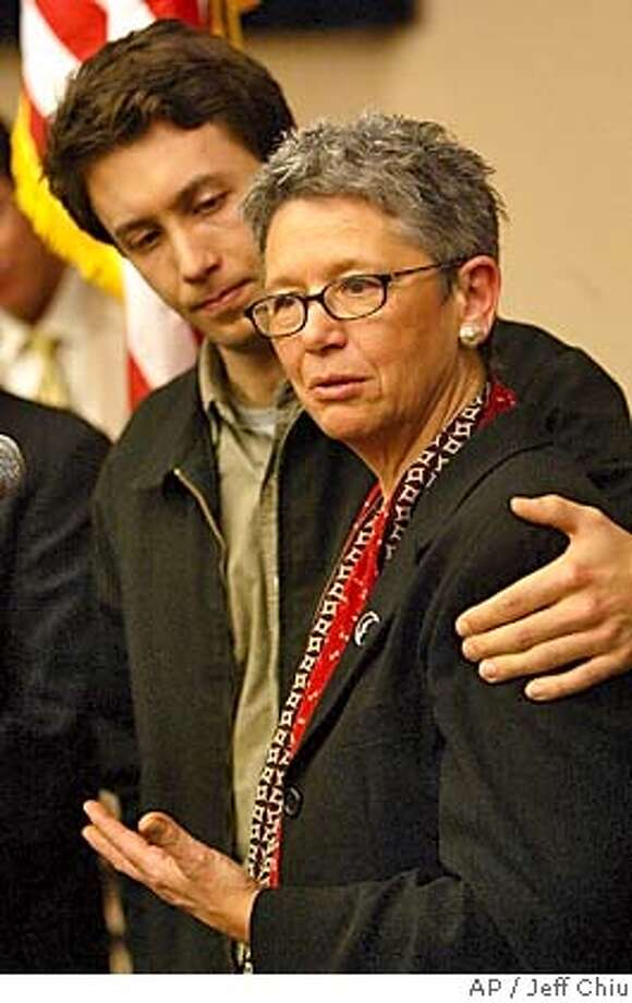 Jeanne Rizzo, with son Christopher Bradshaw, speaks at a news conference at City Hall in San Francisco on Monday, March 14, 2005. Judge Richard Kramer of San Francisco County's trial-level Superior Court ruled Monday that California's ban on was unconstitutional. Rizzo and her partner, Pali Cooper, were among the 12 same-sex Bay Area plaintiffs. (AP Photo/Jeff Chiu) Photo: JEFF CHIU