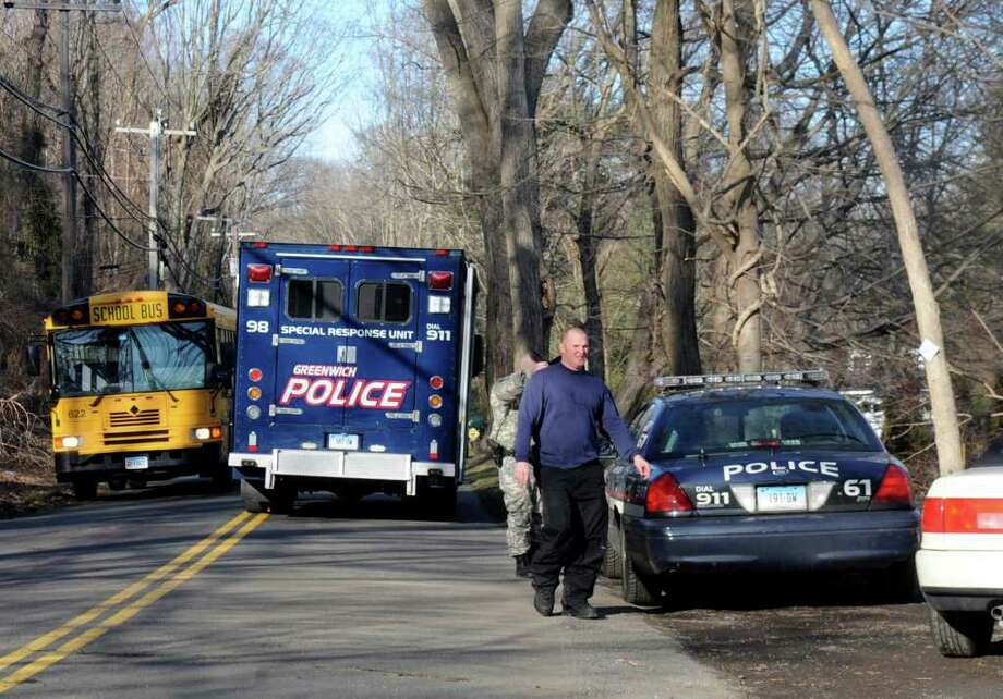 Taconic Road near Interlaken Road in Greenwich was closed Wednesday afternoon, Jan. 25, 2012, during police activity in the area. Photo: Helen Neafsey / Greenwich Time