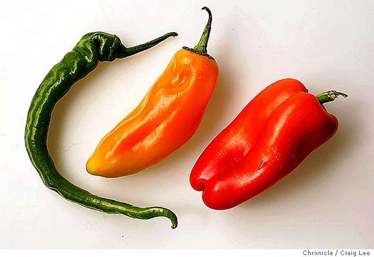 Italian frying pepper (left), Cono di toro pepper (middle) and a Red Gypsy pepper (right). Event on 9/16/04 in San Francisco. Craig Lee / The Chronicle