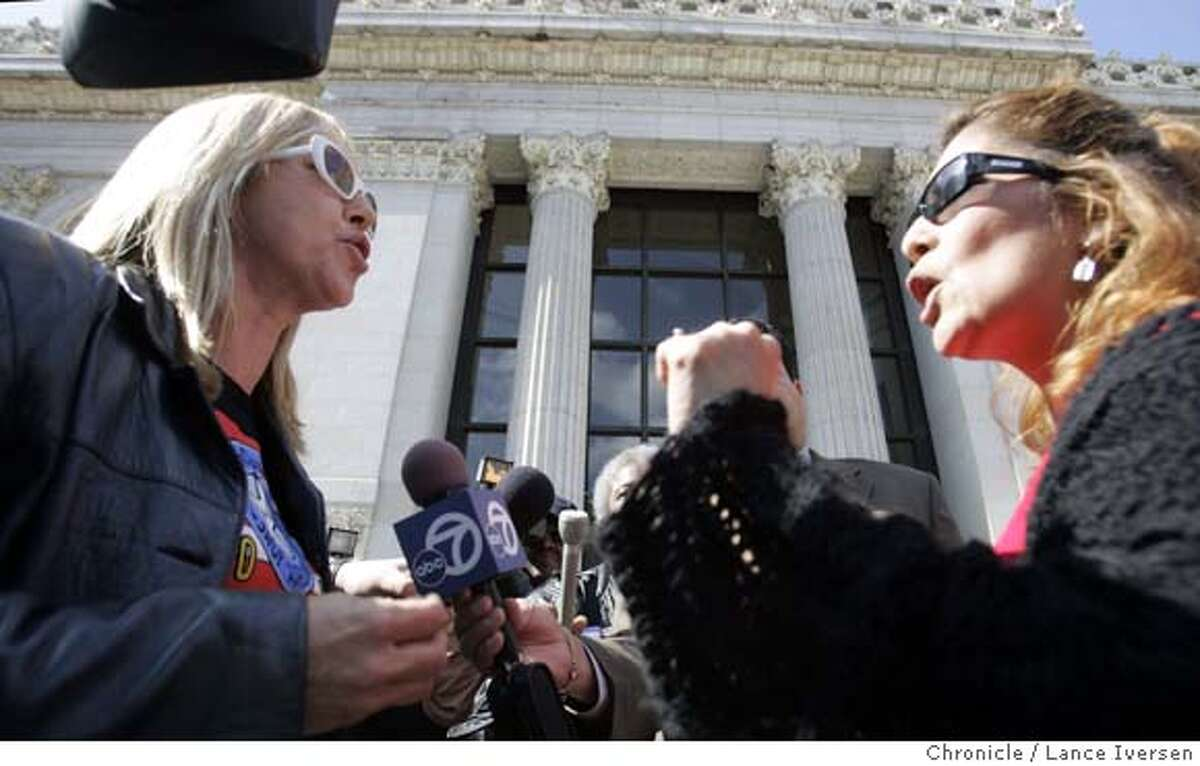 JOHNS03_057.jpg_ Sex workers and their advocates denounce Oakland City Council president Ignacio De La Fuente�s plan to crack down on prostitution along International Boulevard by posting the pictures of Johns on billboards and bus shelters. Robyn Few, left, from Sex Workers Outreach of Berkeley takes point with Shelly Garza a resident of Oakland who was protesting the sex workers protest. By Lance Iversen/San Francisco Chronicle MANDATORY CREDIT PHOTOG AND SAN FRANCISCO CHRONICLE. Ran on: 03-03-2005 Photo caption Ran on: 03-03-2005 Photo caption ##Chronicle#####0422667361
