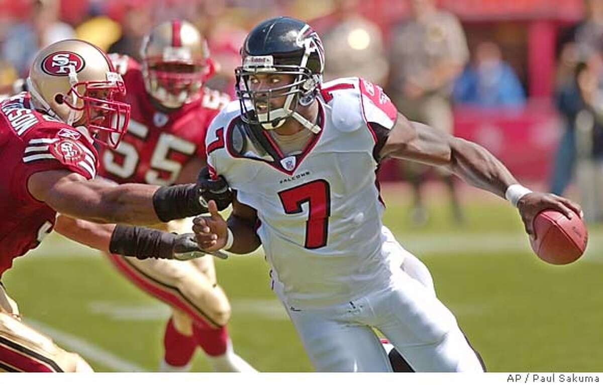 Atlanta Falcons quarterback Michael Vick is about to be sacked by San Francisco 49ers linebacker Julian Peterson, left, in the first quarter, Sunday, Sept. 12, 2004, in San Francisco. (AP Photo/Paul Sakuma)