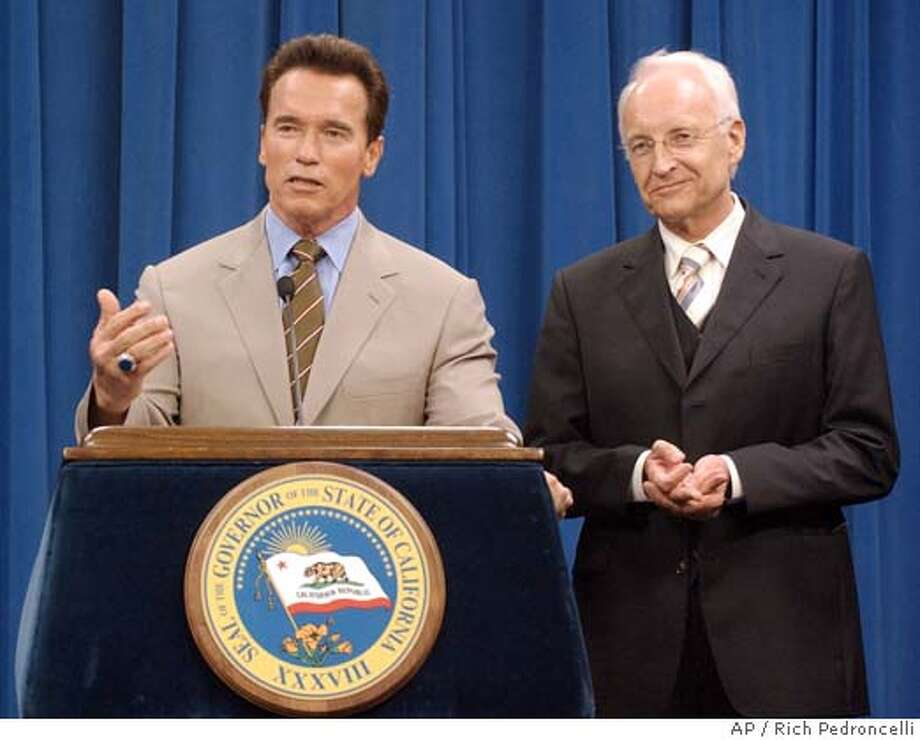 California Gov. Arnold Schwarzenegger, left, makes a few remarks after a meeting with Bavarian Prime Minister Edmund Stoiber, right, at the Capitol in Sacramento, Calif., Thursday, March 10, 2005 The pair had a private meeting where Stoiber presented Schwarzenegger with a box of cigars from Munich, while the Governnor gave the Prime Minister a walking stick. The meeting was part of a Stoiber's week long visit to the United States. (AP Photo/Rich Pedroncelli Ran on: 03-13-2005  Gov. Arnold Schwarzenegger stands next to Bavarian Prime Minister Edmund Stoiber on Thursday in Sacramento. The governor met with the foreign official for an hour but has no meetings scheduled with key Democratic leaders. Photo: RICH PEDRONCELLI